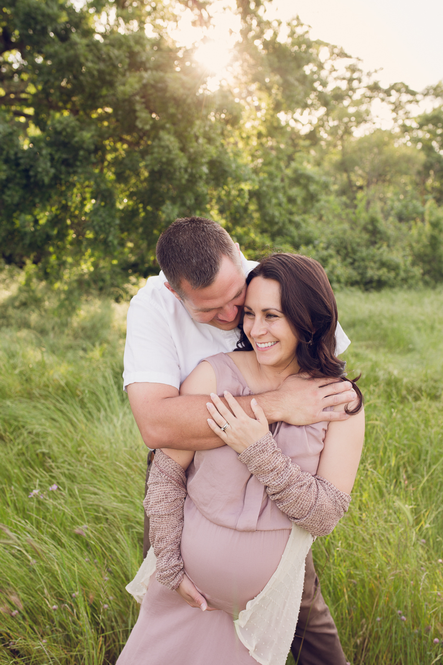 pleasanton maternity photographer with laughing couple