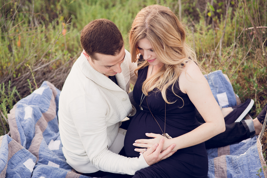 Bay Area Pregnancy Photographer couple on quilt