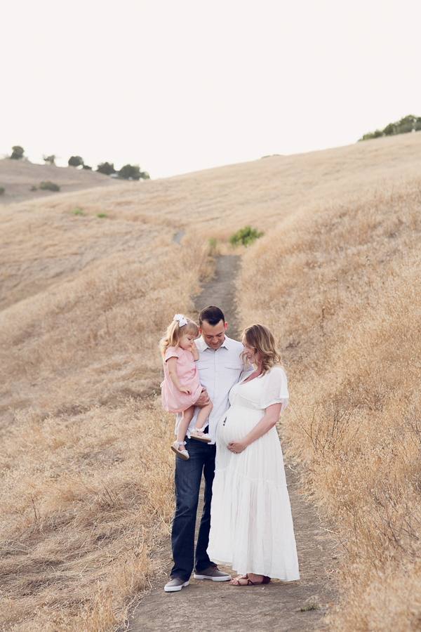 Pleasanton Maternity Photography whole family looking at baby belly