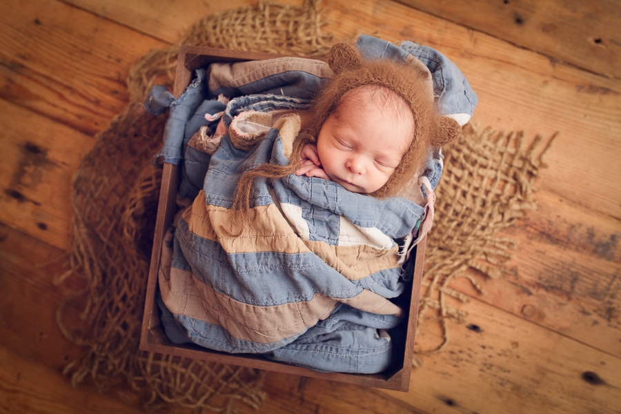 Baby Photographer Livermore baby boy cradled in a quilt