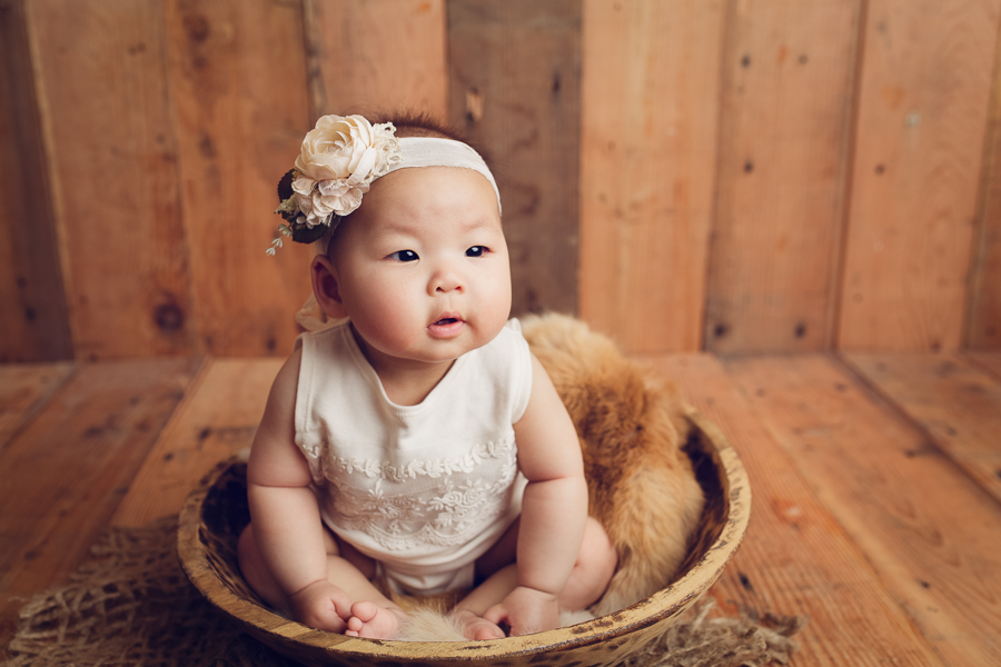 Oakland Baby Photographer baby girl sitting in wooden bowl