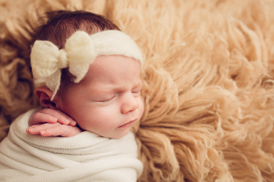 East Bay Area Infant Photographer baby girl wrapped up with a bow